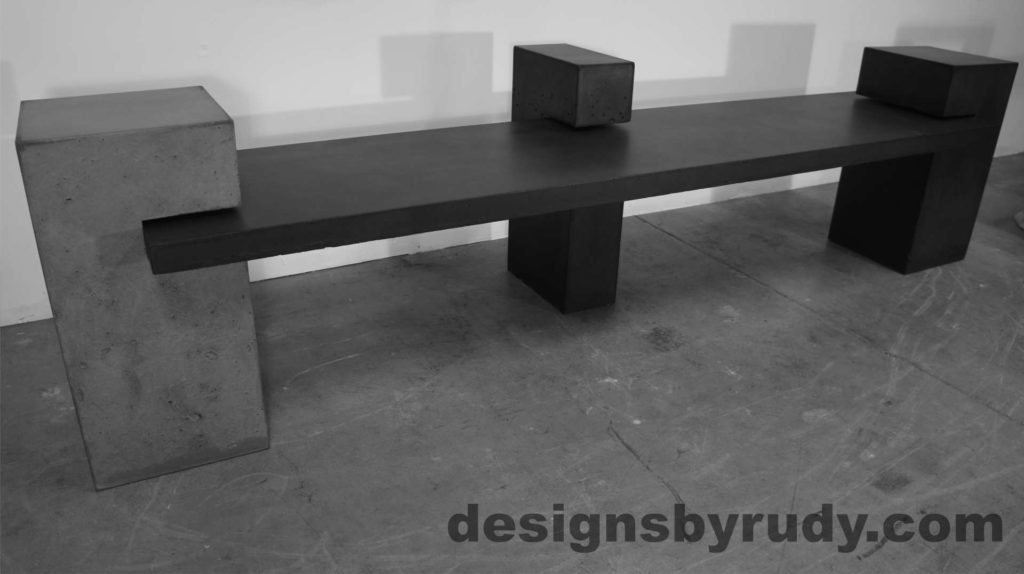 Concrete Bench on three supporting columns, side angle view. Designs by Rudy