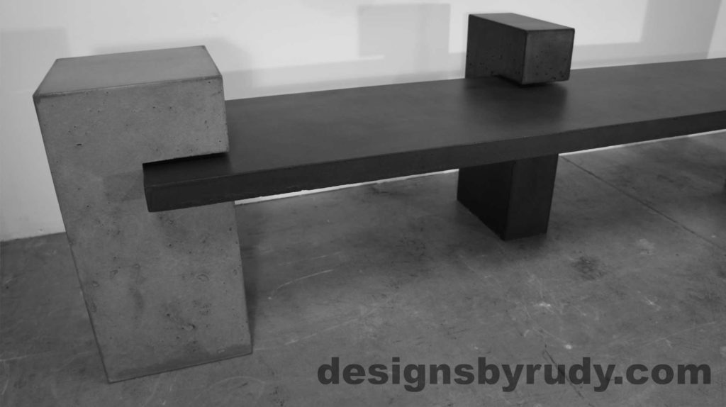 Concrete Bench on three supporting posts, Large gray and middle post closeup. Designs by Rudy