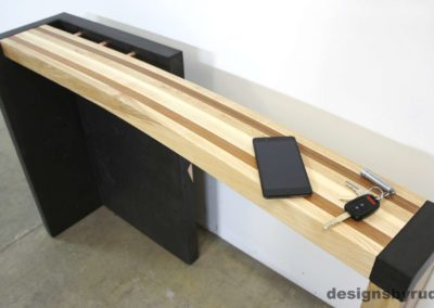 Right curve concrete console table with wooden top, with phone and keys view, Designs by Rudy