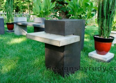Concrete side table DR CB1ST2 low side view closeup with bench in background