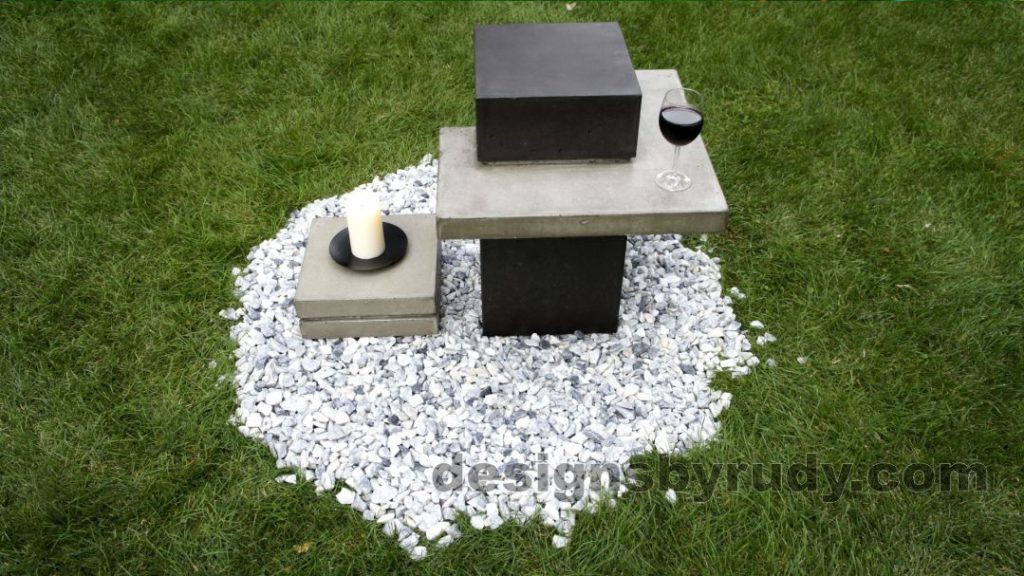 Concrete side table DR CB1ST2 side-front view with candle stand and vine glass