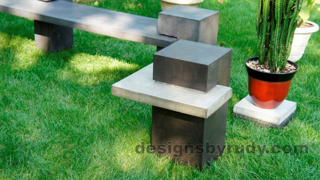 Concrete side table DR CB1ST2 side view closeup with bench