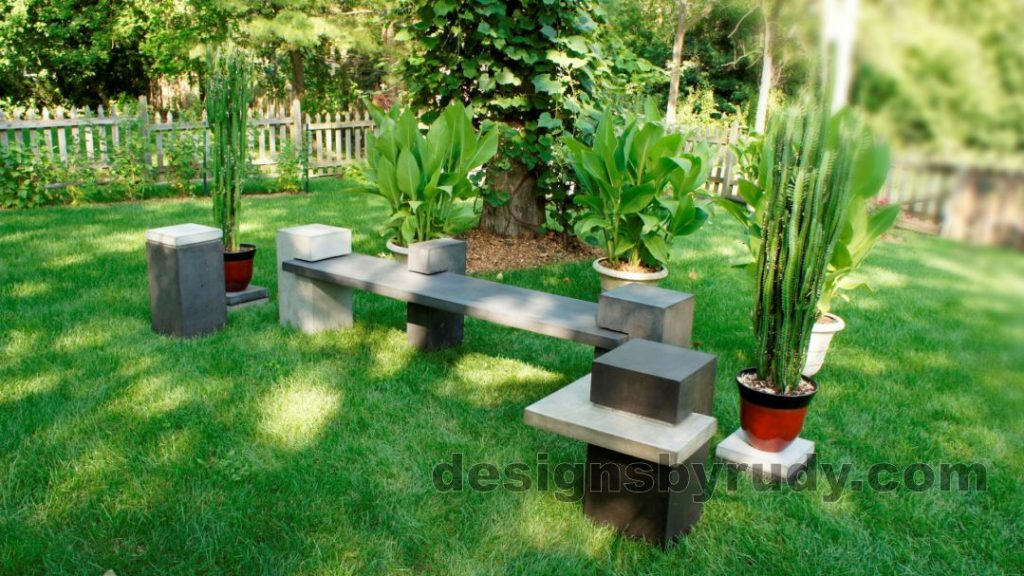 Concrete side table DR CB1ST2 side view with benches and flowers