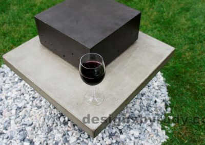 Concrete side table DR CB1ST2 top-front view with vine glass