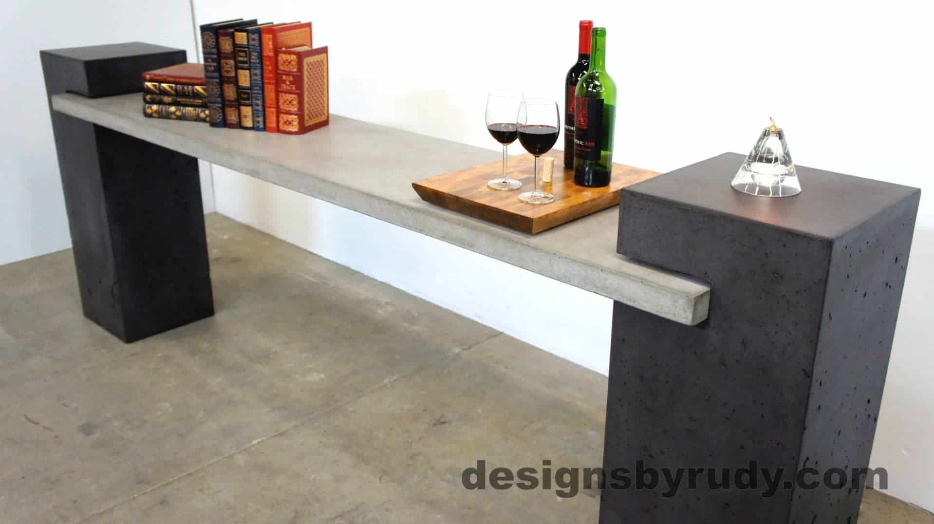 Angle view of a concrete buffet table designed by Designs by Rudy
