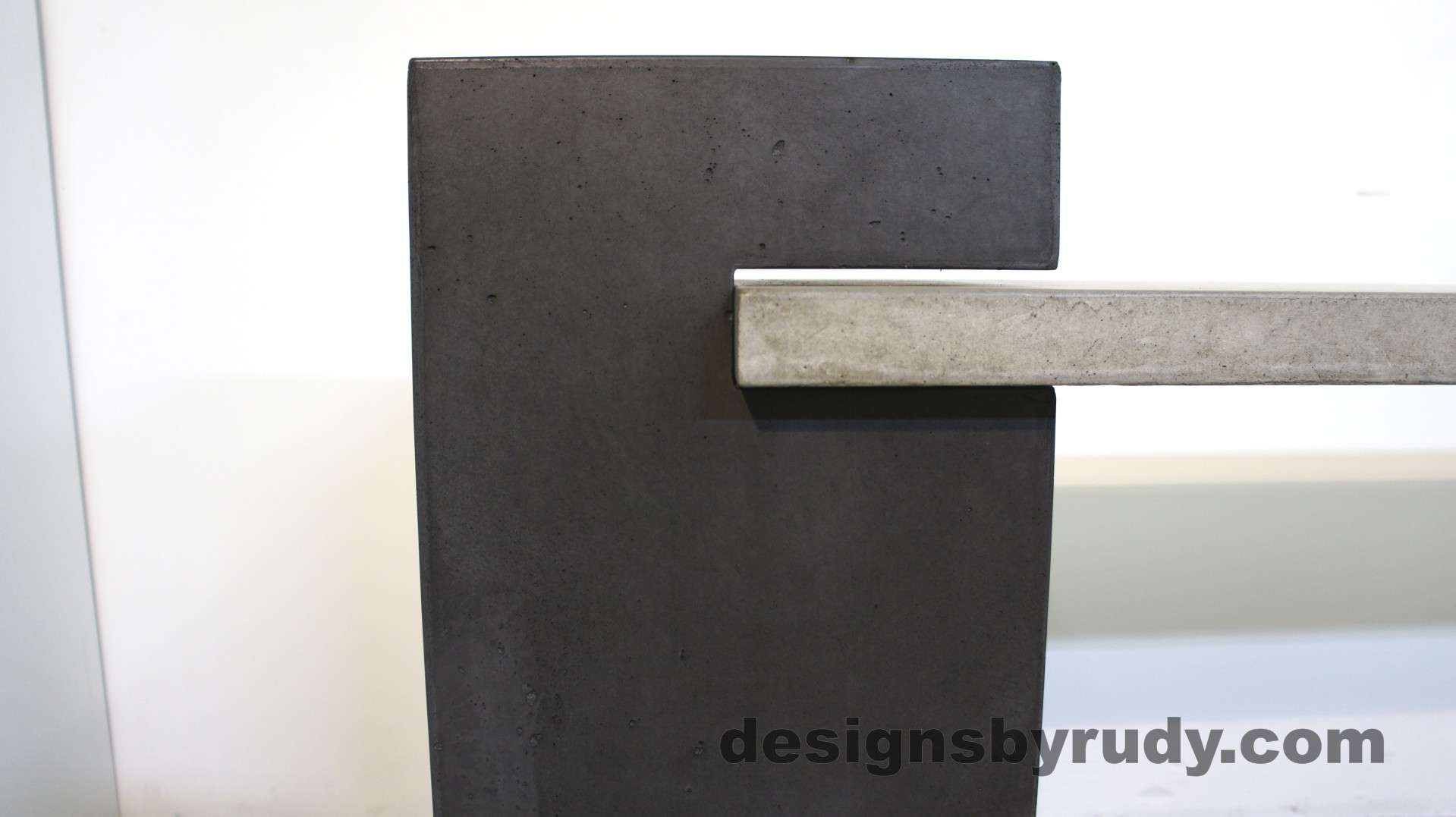 Concrete pedestal and horizontal slab detail of a concrete buffet table designed by Designs by Rudy