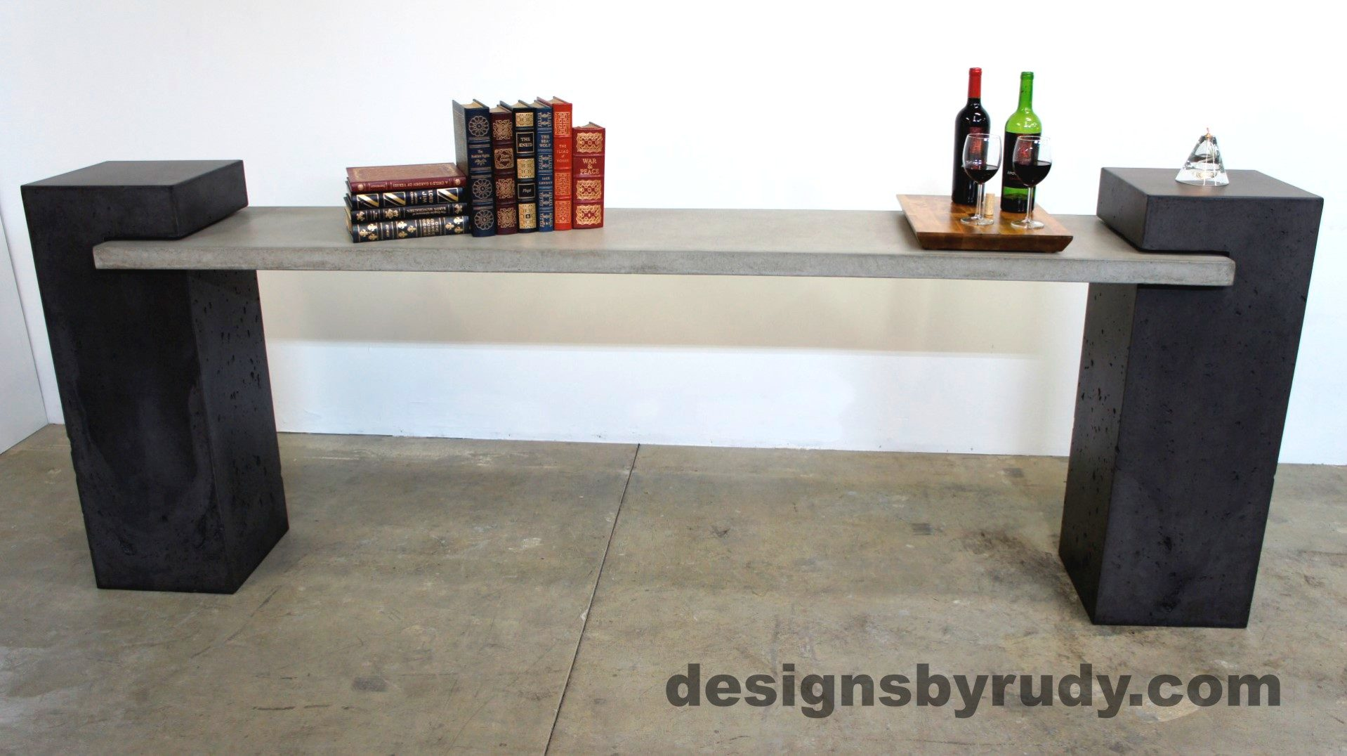 Front view of a concrete buffet table designed by Designs by Rudy