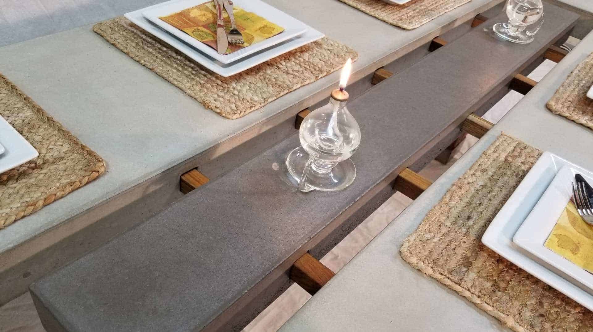 Concrete top dining table on teak legs with center serving tray - closeup, Designs by Rudy
