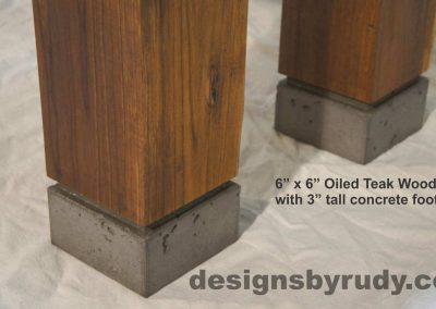 Concrete top dining table on teak legs with concrete footings, Designs by Rudy