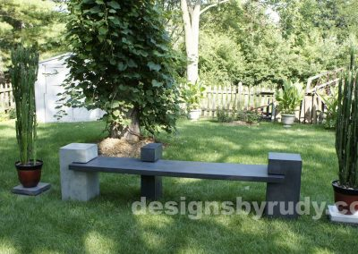 DR CB1 concrete bench on 3 pedestals by Designs by Rudy,garden, natural light, front view