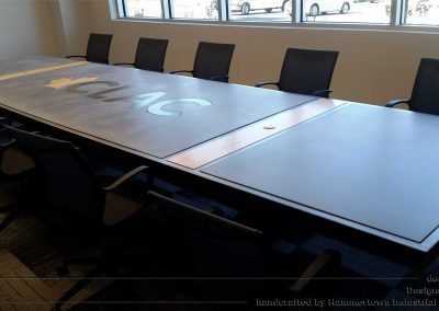 Concrete top and steel frame conference room table designed by Desings by Rudy left view