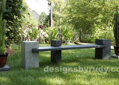 DR CB1 concrete bench on 3 pedestals by Designs by Rudy,garden, natural light, front angle view