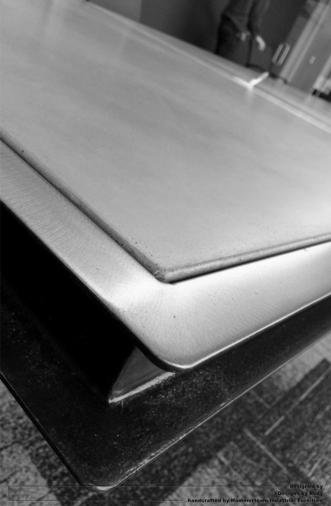 Concrete top and steel frame conference room table designed by Desings by Rudy steel corner detail 3