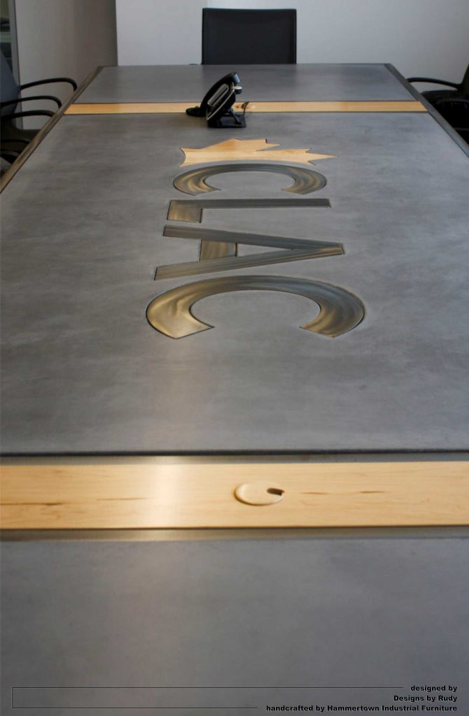 Concrete top and steel frame conference room table designed by Desings by Rudy entire table long view