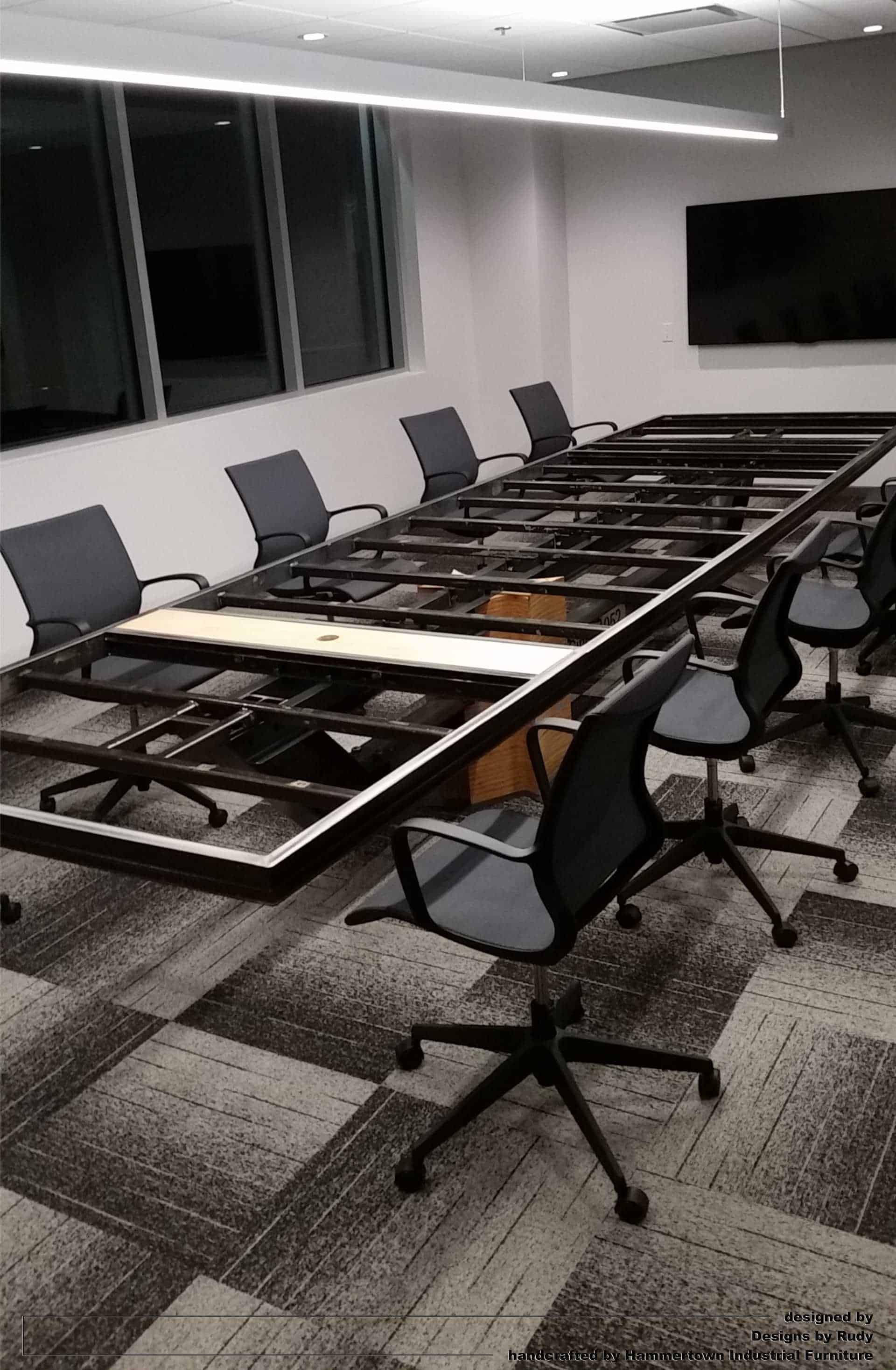 Concrete top and steel frame conference room table designed by Desings by Rudy entire table frame with chairs view