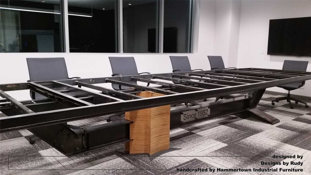 Concrete top and steel frame conference room table designed by Desings by Rudy entire table frame with chairs front view