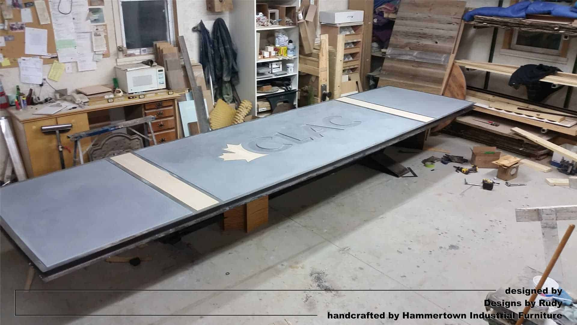 Concrete top and steel frame conference room table designed by Desings by Rudy unfinished table assembled