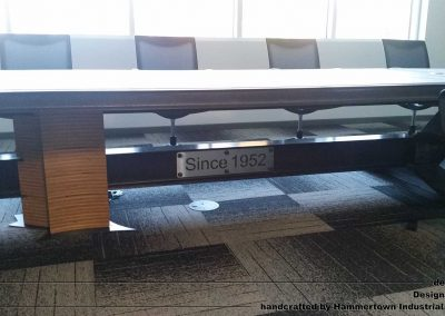 Concrete top and steel frame conference room table designed by Desings by Rudy front low view