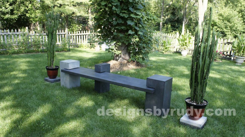 DR CB1 concrete bench on 3 pedestals by Designs by Rudy,garden, natural light, top right angle view