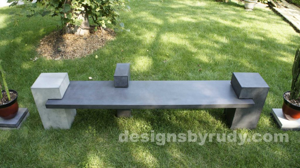 DR CB1 concrete bench on 3 pedestals by Designs by Rudy,garden, natural light, top front view