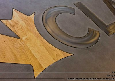Concrete top and steel frame conference room table designed by Desings by Rudy logo leaf detail 1