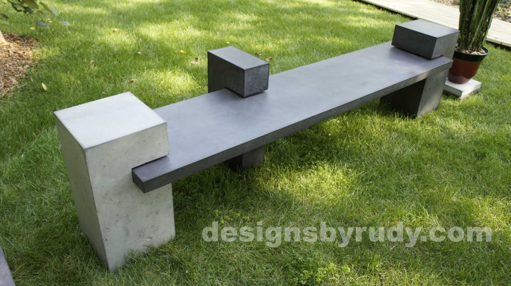 DR CB1 concrete bench on 3 pedestals by Designs by Rudy, garden, natural light, top angle closeup view