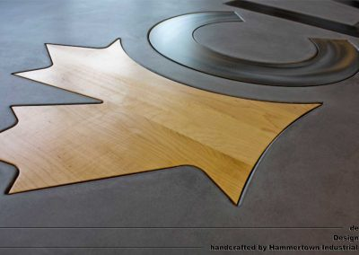 Concrete top and steel frame conference room table designed by Desings by Rudy logo leaf detail 2