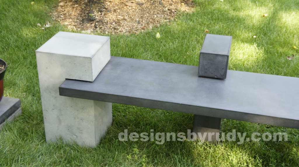 DR CB1 concrete bench on 3 pedestals by Designs by Rudy, garden, natural light, top angle 2 pedestals second view