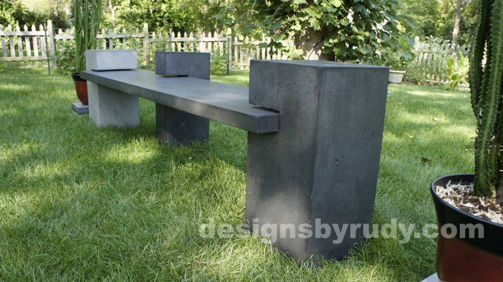 DR CB1 concrete bench on 3 pedestals by Designs by Rudy, garden, natural light, low angle view