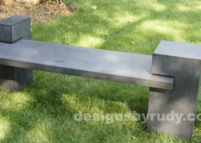 DR CB1 concrete bench on 3 pedestals by Designs by Rudy, garden, natural light, top angle, 2 pedestals view