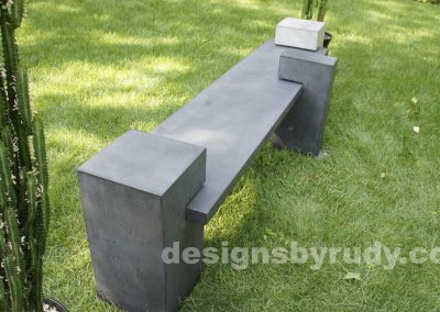 DR CB1 concrete bench on 3 pedestals by Designs by Rudy, garden, natural light, top angle, rear view