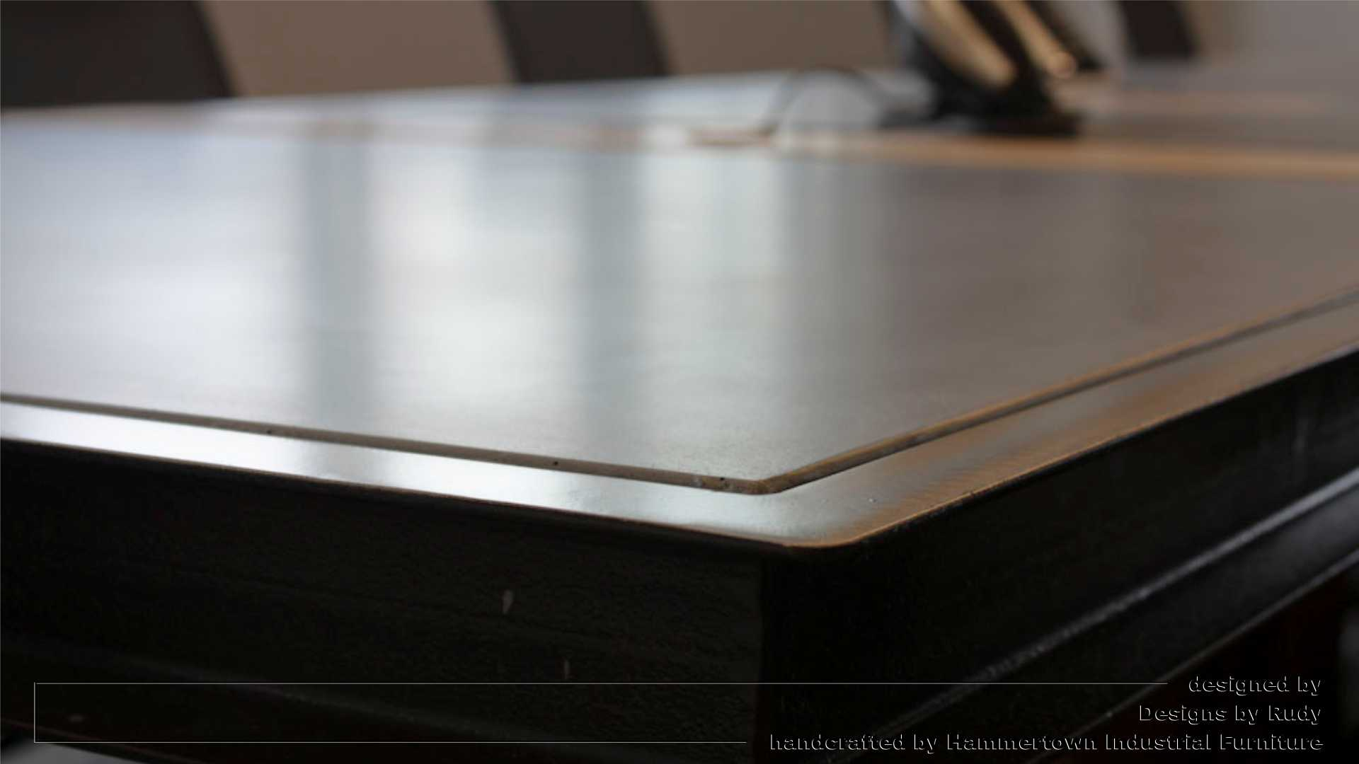 Concrete top and steel frame conference room table designed by Desings by Rudy steel corner detail 1