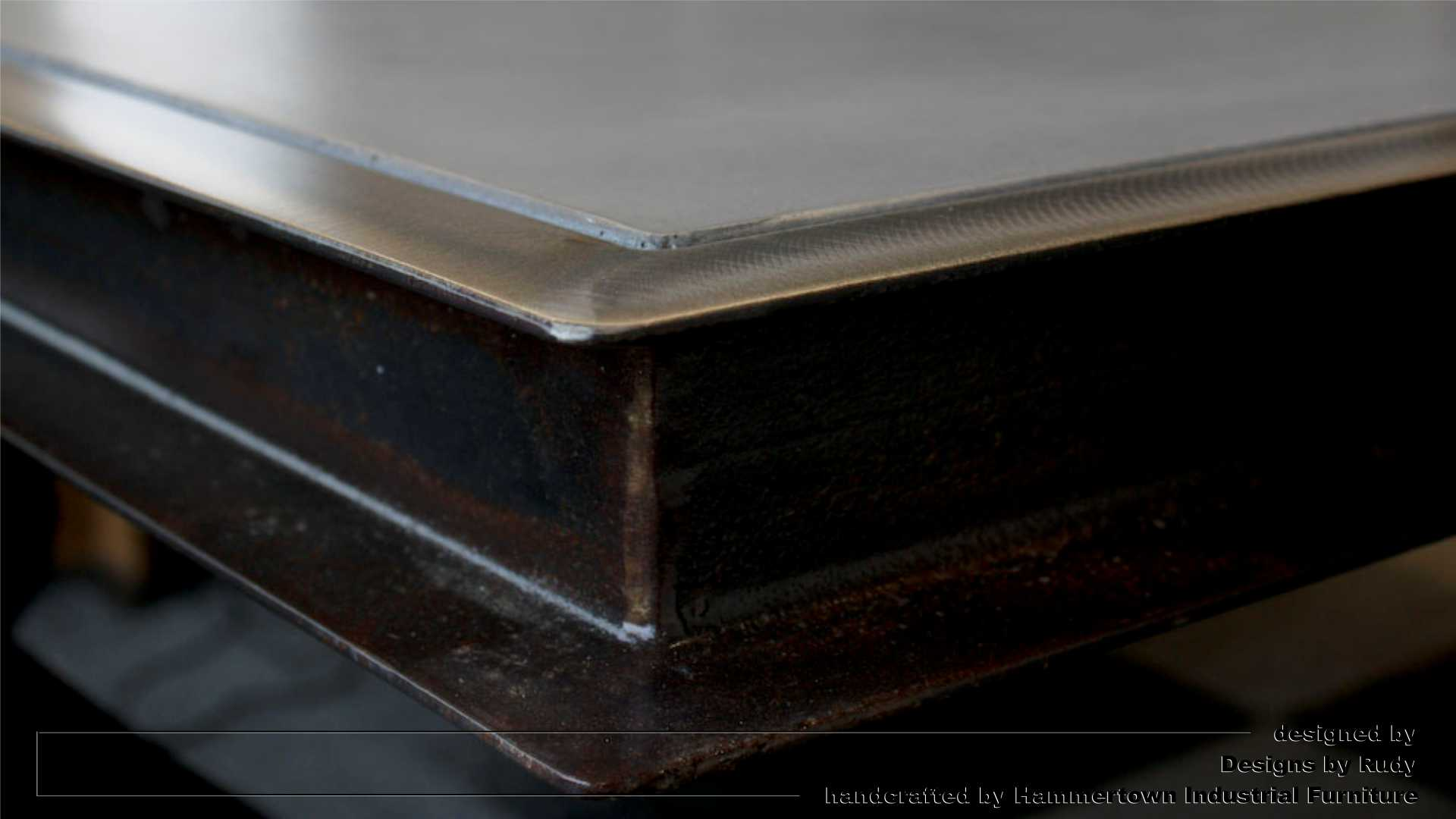 Concrete top and steel frame conference room table designed by Desings by Rudy steel corner detail 2
