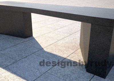 Concrete bench on two triangular pedestals by Designs by Rudy, front right corner view