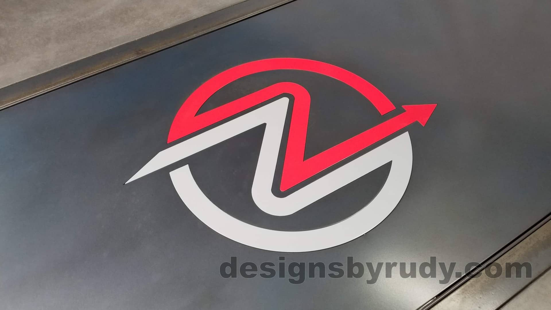13 Steel and concrete conference table, design and fabrication by Designs by Rudy, logo view